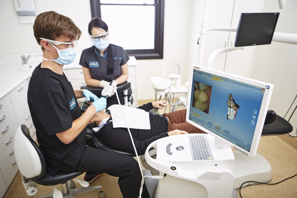 1.3d-scanning-of-prepared-tooth-with-Cerec-omnicam
